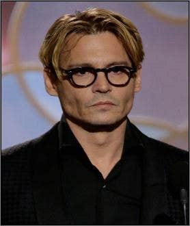 Johnny Depp wearing glasses at Golden Globe Awards